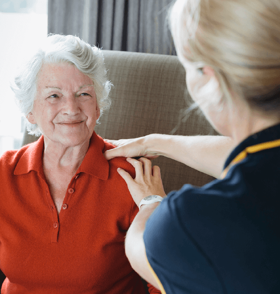 HealthStrong employee providing treatment to woman